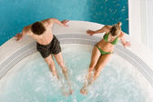 Top view - young couple relax in swimming pool — Stock Photo