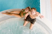 Top view - couple relax in swimming pool — Stock Photo