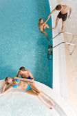 Top view - young relax in swimming pool — Stock Photo
