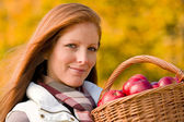 Autumn country - woman with wicker basket — Stockfoto