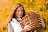 Autumn country - woman with wicker basket — Stok fotoğraf