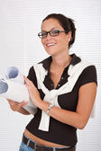 Smiling female architect holding plans — Stock Photo