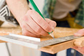 Home improvement - handyman prepare wooden floor — Stock Photo