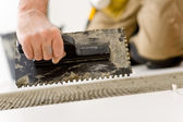Home improvement, renovation - handyman laying tile — Stock Photo