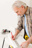 Home improvement - handyman measure porous brick — Stock Photo
