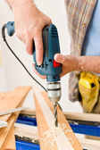 Home improvement - handyman drilling wood — Stock Photo