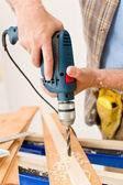 Home improvement - handyman drilling wood — Stock Photo
