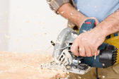 Home improvement - handyman cut wood with jigsaw — Stock Photo