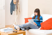Teenager girl relax home with touch screen tablet computer — ストック写真