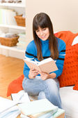Teenager girl home - student read book — Stock Photo