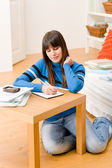 Teenager girl home - student write homework — Stock Photo