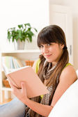 Teenager girl relax home - read book — Stock Photo