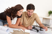 Young man and woman working at architect office — Stock Photo