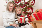 Happy blond woman with child on Christmas — Stock Photo