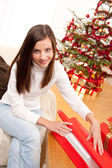 Happy woman wrapping Christmas present — Stock Photo