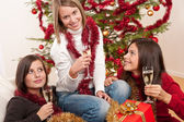 Three young women having fun on Christmas — 图库照片