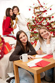 Four young women having fun on Christmas — Stock Photo