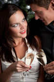 Portrait of extravagant man and woman with champagne — Stock Photo