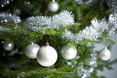 Silver decorated Christmas tree with balls and chains — Stock Photo
