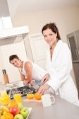 Young woman preparing breakfast — Stock Photo