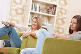 Students - Two female student relaxing home — Stock Photo