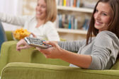 Students - Two female teenager watching television — Stock Photo