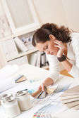 Young female interior designer at office — Stock Photo