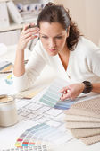 Young female interior designer working at office — Stock Photo