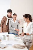 Female interior designer with two clients at office — Stock Photo