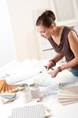 Young female designer working with color swatches — Stock Photo