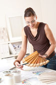 Young female designer with wooden color swatches — Stock Photo