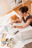 Female interior designer with color swatches — Stock Photo