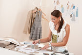 Female fashion designer working with sketches — Stock Photo