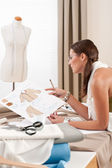 Fashion designer working at studio — Stock Photo