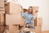 Moving house: Young woman having fun — Foto de Stock