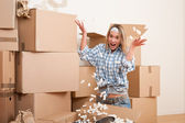 Moving house: Young woman having fun — Stockfoto