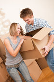 New house: Young couple moving box, unpacking — Stock Photo