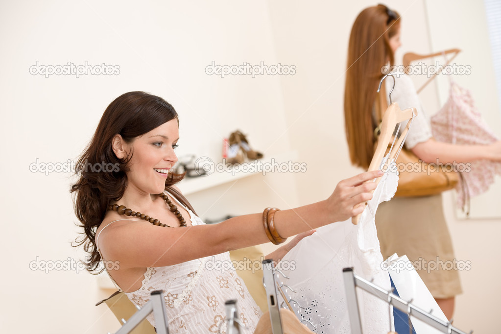 Fashion shopping -  Two happy young woman choose clothes in shop — Stock Photo #4691279