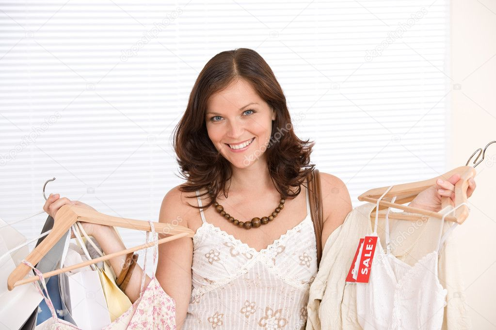 Fashion shopping - Happy woman choose sale clothes, holding shopping bag — Photo #4691356