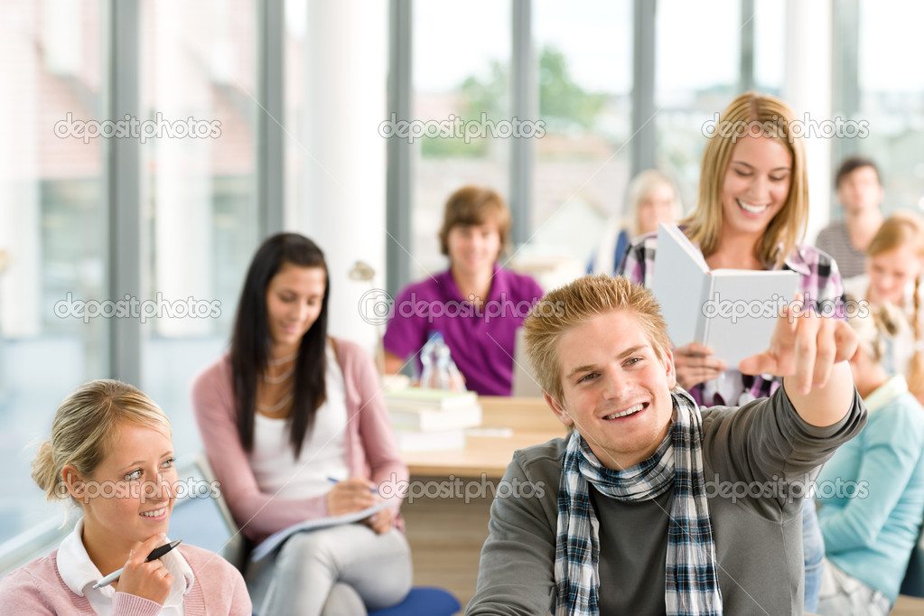 Class at high school - students in classroom pointing — Stock Photo #4692491