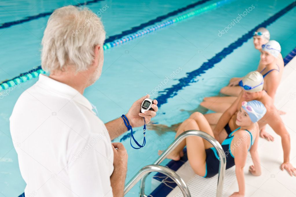 Swimming pool - swimmer training competition in class with coach — Stock Photo #4693355