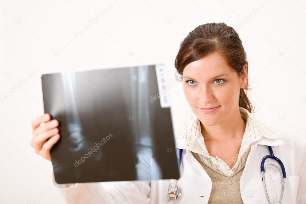 Female doctor holding x-ray checking result — Stock Photo #4693470