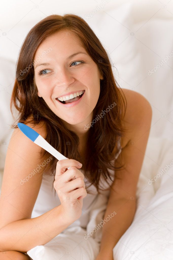 Pregnancy test - happy surprised woman, positive result — Stock Photo #4693972