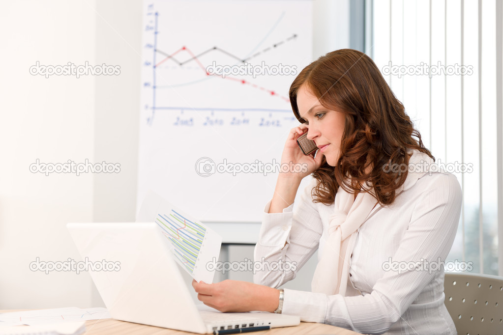 Successful businesswoman at office on phone working with laptop  Stock Photo #4694520