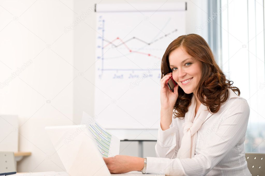 Successful businesswoman at office on phone working with laptop — Stock Photo #4694524