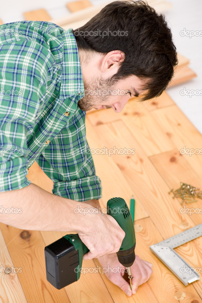 Home improvement - handyman installing wooden floor — Stock Photo #4695021