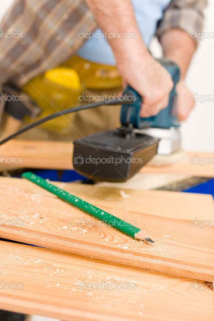 Home improvement - handyman sanding wooden floor in workshop, focus on pencil — Stock Photo #4695223