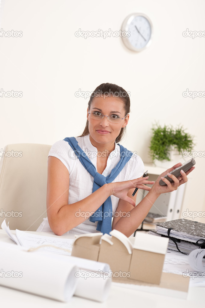 Female architect with phone sitting at the office — Stock Photo #4695428