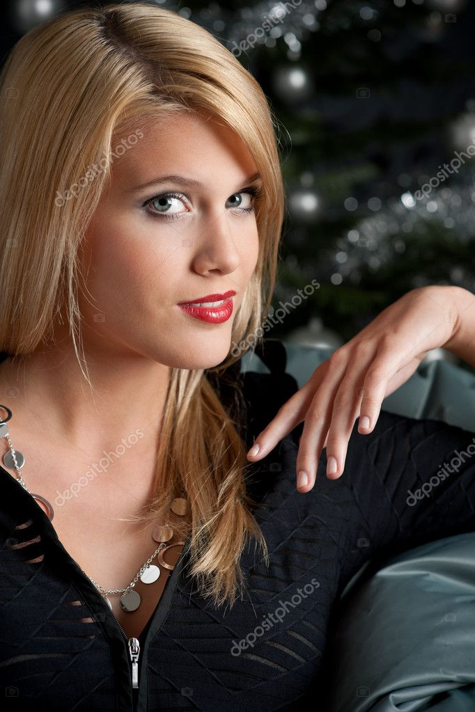 Sexy blond woman on Christmas in front of tree  Stock Photo #4696115