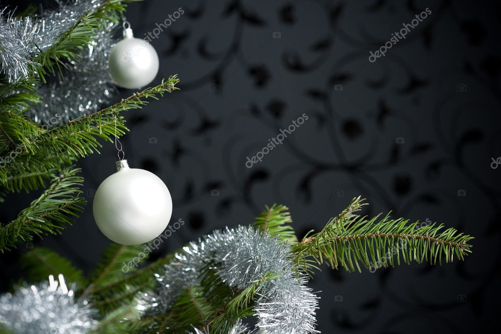 Silver decorated Christmas fir tree with balls and chains, black wallpaper in background  Stockfoto #4696173